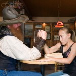 Cowboy Arm Wrestling with Pre-teen Girl